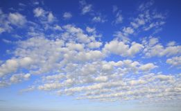 cumulus-cirrus-clouds-blue-sky-56119309